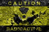 picture of raid  - Radioactive sign on old rusty metal barrel - JPG