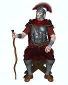 foto of transverse  - Centurion of the Imperial Roman legionary army wearing a transverse crested helmet and sitting on a folding camp stool holding his vine staff as badge of office - JPG