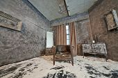 stock photo of sag  - Decoration of abandoned room powdered with snow with old scuffed sagged armchair - JPG