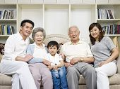 stock photo of grandparent child  - home portrait of a three - JPG