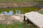 picture of dock a pond  - Wooden dock - JPG