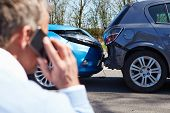 stock photo of people talking phone  - Driver Making Phone Call After Traffic Accident - JPG