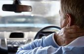stock photo of annoying  - Driver Suffering From Whiplash After Traffic Collision - JPG