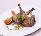 foto of lamb shanks  - lamb shank with vegetables on a white plate