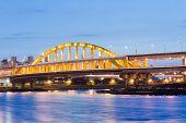 Night scenery of famous attraction landmark, MacArthur bridge, over river in Taipei, Taiwan, Asia. poster