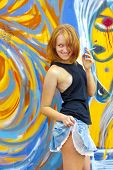 image of streetwalkers  - First year student girl near graffiti wall - JPG