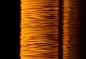 stock photo of transformer  - Rolled copper wire of electrical transformer - JPG