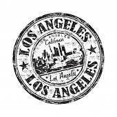 stock photo of population  - Black grunge rubber stamp with the name of Los Angeles city from California written inside the stamp - JPG