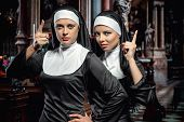 image of nun  - Attractive young nuns posing in the church - JPG