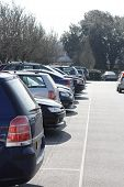 stock photo of parking lot  - a row of cars in a line in a town centre car park - JPG