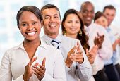 stock photo of applause  - Successful business group applauding at the office - JPG