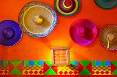 stock photo of sombrero  - Mexican sombreros on the wall - JPG