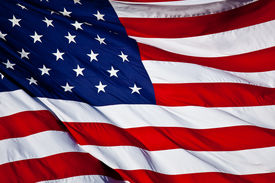 stock photo of waving american flag  - an American flag background waving in the wind - JPG