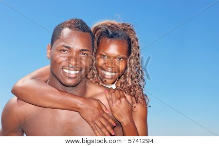 Bright Happy Image Of An African Amercian Couple Smiling Outdoor