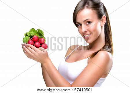 Eat healthily - Beautiful woman holding a bunch of radishes