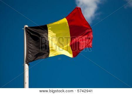 Belgian Flag Against Blue Sky