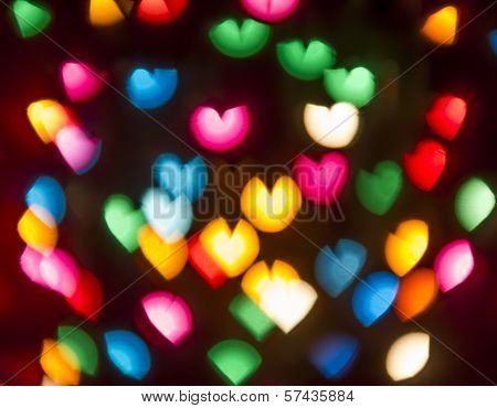 Round Multicolor Heart-shaped Bokeh On A Black Background