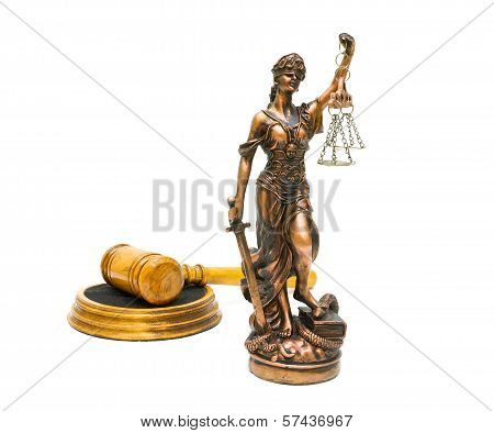 Statuette Of Justice Close Up And Gavel On White Background