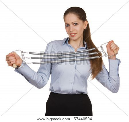 Young Woman Trying To Stretch Expander