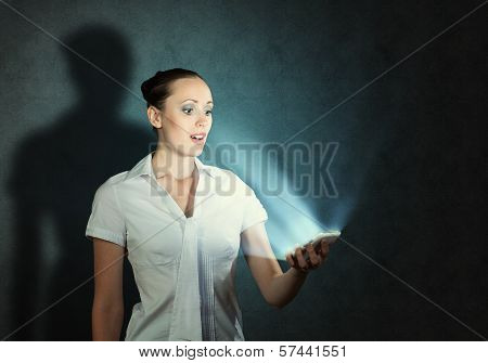 young attractive woman holding a cell phone