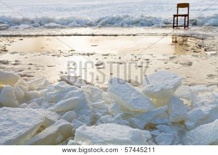 Ice Blocks And Chair On Edge Of Ice-hole