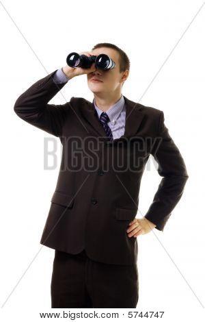 Man In Formal Suit Look Into Binoculars