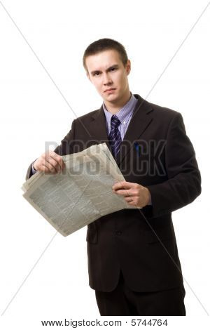 Young Man Reading Newspaper Standing
