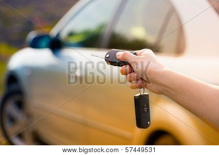 Women's Hand Presses On The Remote Control Car Alarm