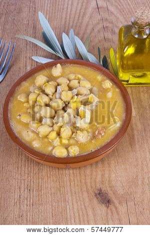 bowl of vegetable soup on wooden background and checkered tablecloth