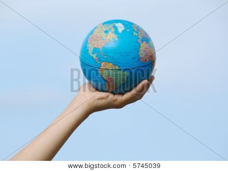 Globe Hold In Childs Hand