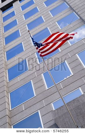 American flag with Office buildings