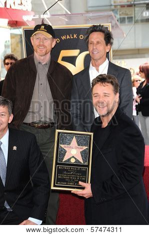 Ron Howard, Russell Crowe and Brian Grazer at the Russell Crowe star ceremony into the Hollywood Walk of Fame, Hollywood, CA 04-12-10