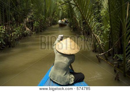 Vietnamese Woman Rowing A Boat