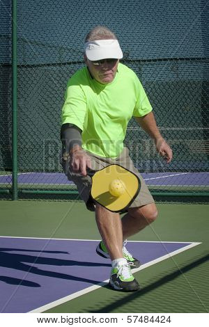 Pickleball Action - Senior Male Player Hitting Backhand Stoke