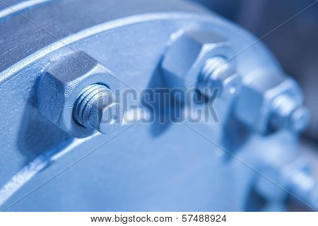 Joint of two flanges by bolts and nuts, selective focus