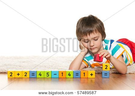 Pensive Clever Boy With Blocks