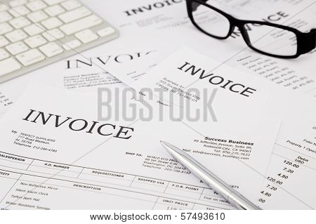 Invoices And Bills On Office Table