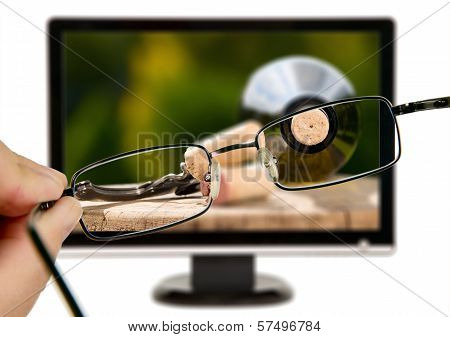 Man Is Viewing To Wine Bottle On Display