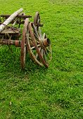 foto of chariot  - old broken wooden wheel spokes side by chariot - JPG