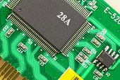 foto of microprocessor  - Large and small microprocessor components on the circuit board green - JPG