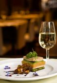 stock photo of gourmet food  - Gourmet dish and white wine restaurant copy space - JPG