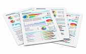 stock photo of financial  - Stack of paper documents with financial reports with color bar graphs pie charts and statistic information data isolated on white background - JPG