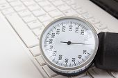 pic of sphygmomanometer  - close up of sphygmomanometer on white notebook keyboard