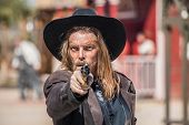 foto of foursome  - Cowboy Points Gun at You in Town - JPG