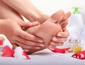 foto of foot massage  - Foot care and foot massage in salon - JPG
