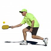 image of pickleball  - Isolated digital image of senior man hitting a forehand stroke during pickleball match - JPG