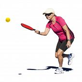 stock photo of pickleball  - Isolated digital image of a senior woman hitting the pickleball during a pickleball match - JPG