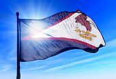 picture of samoa  - American Samoa flag waving on the wind on blue sky - JPG