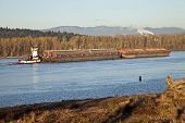 stock photo of barge  - Push boat and barges nautical transportation Columbia river Oregon - JPG