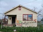 picture of katrina  - animal rescue efforts recorded on the wall of a house in the lower ninth ward neighborhood of new orleans after hurricane katrina. House has since been demolished. photo taken 7 months after hurricane katrina devastated this neighborhood - JPG